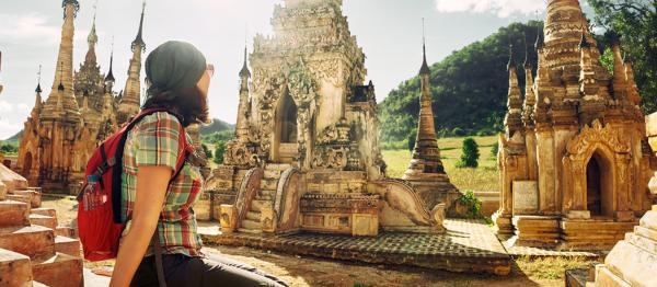 Woman sitting admiring temples.