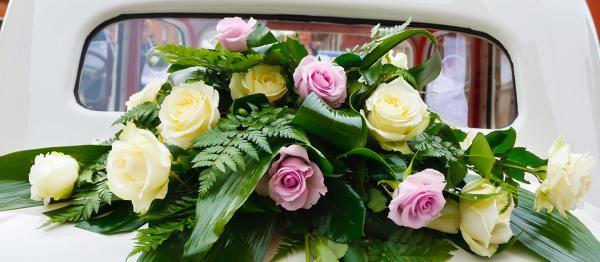 Garland of flowers on wedding car