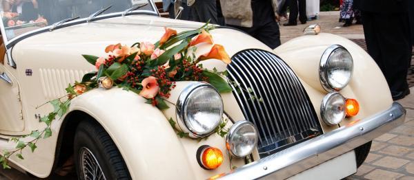 Vintage Wedding Car With Flowers