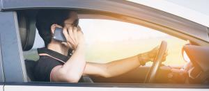 Man talking on mobile phone while driving